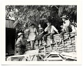 View Dolly and John Sloan and friends sitting on a wall at the Sloan's Santa Fe Ranch digital asset number 0