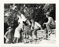 View John and Dolly Sloan and friends sitting on a wall at Sloan's Santa Fe Ranch digital asset number 0