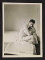 View Morris Louis seated on the edge of a bed digital asset number 0