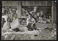 View A woman and sleeping child at Coney Island digital asset number 0