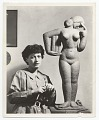View Unidentified female sculptor with her work digital asset number 0
