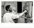 View Augustus Saint-Gaudens working on a bas-relief sculpture digital asset number 0