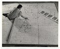 View Photograph of woman working on a floor mosaic digital asset number 0