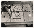 View Photograph of man working on a floor mural digital asset number 0