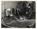 View Photograph of men working on a floor mural digital asset number 0