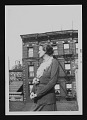 View Photograph of Anne Ryan in front of New York apartment buildings digital asset number 0
