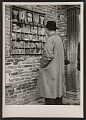 View Ben Shahn looking at postcards digital asset number 0