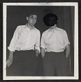 View Two teenage boys with their hands in their pockets digital asset number 0