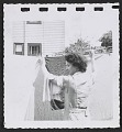 View Women hanging laundry digital asset number 4