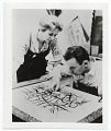 View Romas Viesulas examining a lithographic stone with June Wayne digital asset number 0