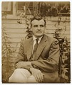 View Russell Cheney sitting in front of a house digital asset number 0