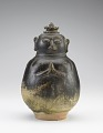 View Gourd-shaped bottle in form of a worshipper; neck missing, lid a modern addition digital asset number 0