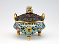 """View Incense burner in shape of a tripod (li) with design of lotus and with three kinds of fruit (the """"three plenties"""") on the underside of vessel digital asset number 0"""