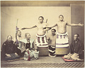 View [Two wrestlers with retainers] digital asset: [Two wrestlers with retainers], [graphic]