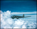 View Eastern Air Lines Collection digital asset: One-half left front view of Eastern Air Lines Douglas DC-3 (r/n N18196, ship no. 384) in flight over dramatic cloud layer; circa late 1930s.