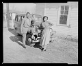 View Outdoor Photo of a Mother, Father and Child Standing by a Car digital asset number 0
