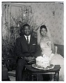 View Indoor Portrait of the Bride and Groom Sitting with the Wedding Cake digital asset number 0