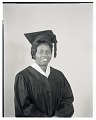 View Studio Portrait of a Woman Sitting Wearing a Cap and Gown digital asset number 0