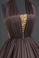 View Brown halter dress with gold music themed embellishments designed by Peter Davy digital asset number 2