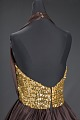 View Brown halter dress with gold music themed embellishments designed by Peter Davy digital asset number 3