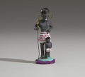 View Figurine in the form of a caricatured African woman and child digital asset number 1