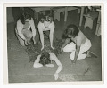 View Photograph of four young women practicing first aid digital asset number 0