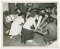 View Photograph of young women practicing first aid digital asset number 0