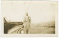 View Photograph of an unidentified man in front of car digital asset number 0