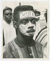 """View Photographic print of a man with """"Vote"""" face paint in the Selma-Montgomery march digital asset number 0"""