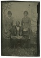 View Tintype photograph of a man identified as James Turner, with two women digital asset number 2
