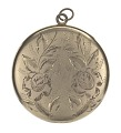View Locket with photographs of Harriette and Harry T. Moore digital asset number 2