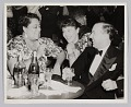 View Photograph of a man and two women seated at a table digital asset number 0