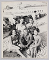 View Photograph of a man and four women sitting on a beach digital asset number 0