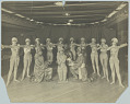 View Photograph of two men and eleven women posing in stage costumes digital asset number 0