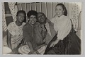 View Photograph of Laura Cathrell, a man, and two women at a party digital asset number 0