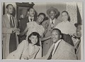 View Photograph of Laura Cathrell and a group of men and women at a party digital asset number 0