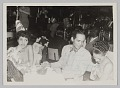 View Photograph of a man and two female performers seated at a table at Club 845 digital asset number 0