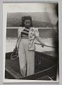 View Photograph of Birdie Warfield Edison standing in boat digital asset number 0