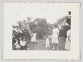 View Photographic print of women and children outside digital asset number 0