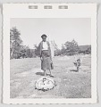 View Photographic print of a woman standing by a gravesite digital asset number 0
