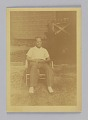 View Chromogenic print of a man sitting in a lawn chair digital asset number 0