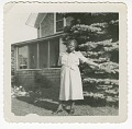 View Digital image of a woman outside the Taylor family home on Martha's Vineyard digital asset number 0