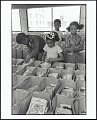 View <I>Panther Free Food Program. Children Prepare Bags of Food for Distribution at the Oakland Coliseum at the Black Panther Community Survival Conference, Oakland, California, March 1972</I> digital asset number 0