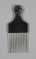 View Afro hair comb with black fist design digital asset number 0