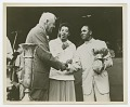 View Photograph of Althea Gibson standing next to two men shaking hands digital asset number 0