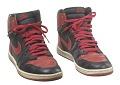 View Pair of red and black Air Jordan I high top sneakers made by Nike digital asset number 2