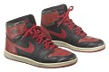 View Pair of red and black Air Jordan I high top sneakers made by Nike digital asset number 0