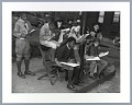 View Photographic print of Boy Scouts with notepads on sidewalk digital asset number 0