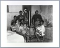 View Photographic print of the Berry family gathered around pot belly stove digital asset number 0