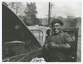 "View Photographic print of auto mechanic Sam ""Scotty"" Scott digital asset number 0"